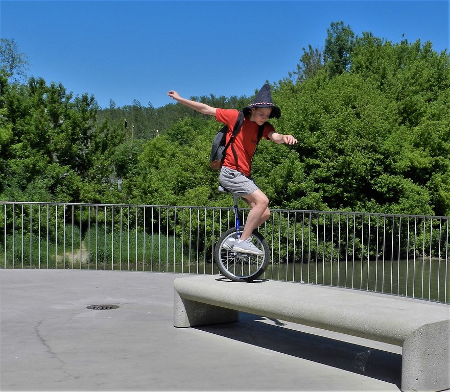 Unicycle challenge on bench